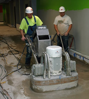 Workers polishing a concrete floor